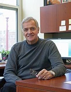 Dr Timothy Austin at desk